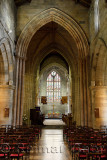 Apse with stained glass window and Nave interior of the medieval historic Church of the Holy Rude in Stirling Scotland UK