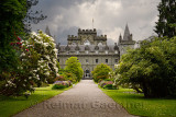 Turreted Inveraray Castle in Gothic Revival style from the flower gardens with dark clouds in the Scottish Highlands Scotland UK
