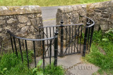 Kissing Gate with stone wall at pastureland under Stirling Castle that lets people but not sheep pass through