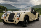 Woman in a hand made wood shell Morgan roadster car in the Scottish Highlands near Kilchurn Castel at Loch Awe Scotland UK