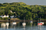 Evening sunlight on sailboats in the harbour of Ardmucknish Bay of Connel Scotland UK near Oban