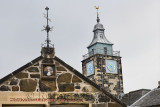Quarrelling is Taboo on the Stirling Boys Club building with The Tolbooth clock tower Stirling Scotland UK
