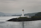 Lismore Lighthouse on Eilean Musdile Islet and Achanduin Castle ruins on Lismore Island Scotland UK