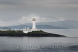 Lismore Lighthouse on Eilean Musdile Islet off Lismore Island with rain and mist over the west coast highlands Scotland UK