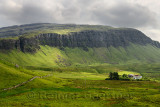 Farm at Balmeanach with cliffs of Creag a Ghaill green slopes and on Loch Na Keal Isle of Mull Scottish Highlands Scotland UK