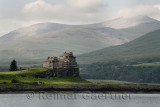Scaffolding on Duart Castle on the Firth of Lorn Isle of Mull in west coast highlands and Dun da Ghaoithe mountain Scotland UK