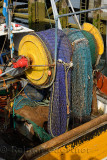 Colorful net on a reel at stern of a commercial trawler fishing boat in Oban Bay harbour Scotland UK