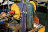 Colorful net on a reel at stern of a commercial trawler fishing boat in Oban harbour Scotland UK
