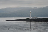 Lismore Lighthouse on Eilean Musdile Islet off Lismore Island on the Firth of Lorn in wet weather with west coast highlands Scot