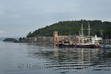 Sailing ships moored in Oban Harbour with St Columba's Cathedral on Oban Bay in the morning Scotland UK