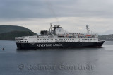 Morning departure of Ocean Endeavour arctic cruise ship of Adventure Canada in Firth of Lorn out of Oban Bay Scotland UK