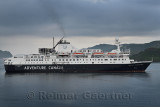 Morning departure of Ocean Endeavour arctic cruise ship of Adventure Canada in Firth of Lorn at Oban Bay Scotland UK