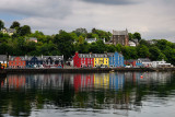 Colorful houses reflected in the water of Tobermory harbour on the Isle of Mull Scottish Inner Hebrides Scotland UK