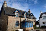 Stone house with blue trim on main street of Baile Mor village on Isle of Iona Inner Hebrides Scotland UK