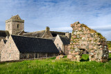Medieval pink granite stone ruins of the Bishop's House next to the museum at Iona Abbey monastery on Isle of Iona Inner Hebride