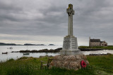 Marble Celtic cross war memorial on Martyr's Bay Sound of Iona South of Baile Mor village on Isle of Iona Inner Hebrides Scotlan