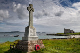 Marble Celtic cross war memorial with wreath on Martyr's Bay Sound of Iona South of Baile Mor village on Isle of Iona Inner Hebr