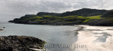 Panorama of sea cliffs and pasturland at Sandeels Bay above sandy beach on Isle of Iona Inner Hebrides Scotland UK