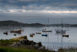 Baile Mor village harbour at dusk with moored boats and sailboats on the Sound of Iona looking from Isle of Iona to Fionnphort I