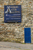 Stone wall of Argyll Arms Hotel with blue sign open to non residents in Bunessan on Isle of Mull Scotland UK