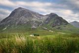 White cottage at foot of Stob Dhearg peak of Buachaille Etive Mor mountains on river Coupall Glen Coe Scottish Highlands Scotlan