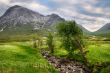 Stream to River Coupall valley with white cottage at foot of Stob Dhearg peak of Buachaille Etive Mor mountains Glen Coe Scotlan