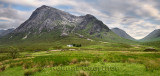 Panorama of white cottage on River Coupall valley with Stob Dhearg peak of Buachaille Etive Mor range at Glen Coe Scottish Highl
