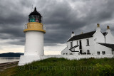 White Corran Lighthouse and Lodge under dark clouds in Ardgour on Isle of Mull Ferry terminal on Loch Linnhe Scotland UK