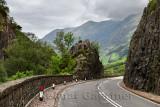 Curving Highway A82 through rock cliffs with Aonach Eagach Ridge mountains north of Glen Coe valley Scottish Highlands Scotland