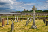 Ancient tombstones and Celtic cross at Kilpatrick Cemetery next to Duart Castle on Isle of Mull on Sound of Mull Loch Linnhe Sco