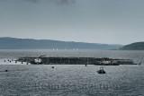 Fishnish marine farm of net pens aquaculture on the Sound of Mull with sailboats from Fishnish Lochaline Ferry Scotland UK