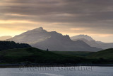 Ben Tianavaig peak at sunset from Sconser on Loch Sligachan with Ben Chracaig and The Storr peaks in distance Isle of Skye Scotl