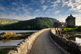 Evening light on new stone arch footbridge to restored Eilean Donan Castle on Island at three lochs in Scottish Highlands Scotla