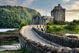 Evening light on restored Eilean Donan Castle on Island at three lochs with added stone arch footbridge Scottish Highlands Scotl