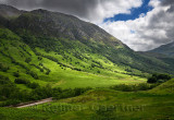 Five Finger Gulley leading up to cloud covered Ben Nevis mountain and green slopes to River Nevis Scottish Highlands Scotland UK