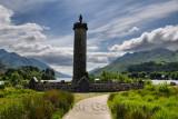 Glenfinnan Monument to the Jacobite uprising with mountains around Loch Schiel in Lochaber Scottish highlands Scotland United Ki