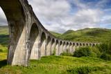 Arched columns of curving Glenfinnan Viaduct for West Highland Line train Lochaber Scottish Highlands Scotland United Kingdom