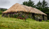 Colbost Croft Museum Blackhouse with stone walls and rocks holding netting for thatched roof Isle of Skye Scotland UK