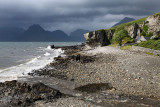 Allt Port na Cullaidh river at Elgol beach with Red Cuillin Mountains under clouds at Loch Scavaig Scottish Highlands Isle of Sk