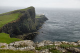 Neist Point Lighthouse in high winds and stinging rain with sheer basalt cliffs to Oisgill Bay Atlantic Ocean Isle of Skye Scotl