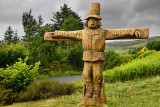 Carved wood Tattie Bogle Scarecrow previously pointing to the Tattie Bogal trail on Carbost Road Drynoch Isle of Skye Scotland