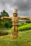 Carved wood life size Tattie Bogle Scarecrow previously pointing to the Tattie Bogal trail on Carbost Road Drynoch Isle of Skye