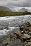 River Sligachan rapids after a storm with Marsco peak of Red Cuillin mountains Isle of Skye Scottish Highlands Scotland UK