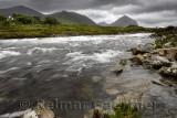 Beinn Dearg Mhor, Beinn Dearg Mheadhonach and Marsco peaks of Red Cuillin mountains at Sligachan river after a rain storm Isle o