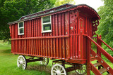 Red painted Gypsy Traveler Caravan parked at Cawdor Castle grounds Nairn Scotland UK