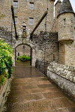Front of Cawdor Castle with turret and drawbridge with bell and Stags Head Buckel Be Mindfull emblem in the rain Cawdor Nairn Sc