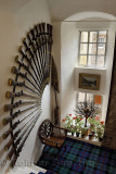 Musket rifle collection display in front staircase of Cawdor Castle with Clan Campbell of Cawdor tartan rug Scotland UK