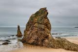 Three Kings red rock quartzite sea stacks on Cullen Bay beach on the North Sea at Cullen Moray Scotland UK