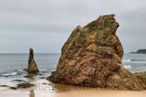 Three Kings red quartzite sea stacks on Cullen Bay beach on the North Sea Moray Scotland UK