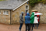 Women lined up for the Ladies room toilet in the rain at Cawdor Castle Nairn Scotland UK
